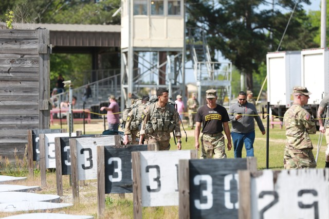 FORT BENNING, Ga. (April 13, 2018) -- 2018 Best Ranger competitors walk to one of the ranges along Dixie Road at Fort Benning main post. On the first day of the 2018 Best Ranger Competition, 51 teams of two Ranger-qualified U.S. military service members took on several events to test their physical endurance, mental acumen, and technical and tactical skills. The 35th David E. Grange Jr. Best Ranger Competition, an annual competition organized by the Airborne and Ranger Training Battalion, is set to determine the most elite Ranger-qualified two-athlete team of the Armed Services April 13 through 15 at Fort Benning, Georgia. (U.S. Army photo by Markeith Horace, Maneuver Center of Excellence, Fort Benning Public Affairs Office)
