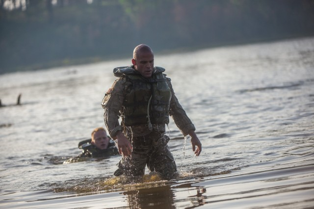 FORT BENNING, Ga. (April 13, 2018) -- Capt. Travis Cornwall, foreground, and Staff Sgt. Erich Friedlein, midground, Team 44 from the National Guard, emerge from Victory Pond. On the first day of the 2018 Best Ranger Competition, 51 teams of two Ranger-qualified U.S. military service members took on several events to test their physical endurance, mental acumen, and technical and tactical skills. The 35th David E. Grange Jr. Best Ranger Competition, an annual competition organized by the Airborne and Ranger Training Battalion, is set to determine the most elite Ranger-qualified two-athlete team of the Armed Services April 13 through 15 at Fort Benning, Georgia. (U.S. Army photo by Patrick Albright, Maneuver Center of Excellence, Fort Benning Public Affairs Office)