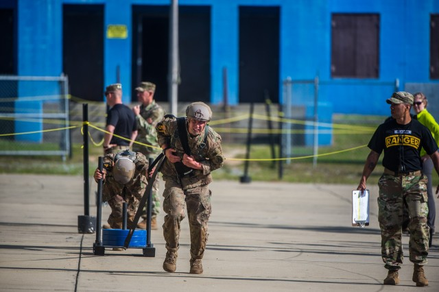 FORT BENNING, Ga. (April 13, 2018) -- Capts. Robert Doyle and Taylor Moran, Team 51 from the Maneuver Center of Excellence at Fort Benning, Georgia, move a weighted sled during the Urban Obstacle Course. On the first day of the 2018 Best Ranger Competition, 51 teams of two Ranger-qualified U.S. military service members took on several events to test their physical endurance, mental acumen, and technical and tactical skills. The 35th David E. Grange Jr. Best Ranger Competition, an annual competition organized by the Airborne and Ranger Training Battalion, is set to determine the most elite Ranger-qualified two-athlete team of the Armed Services April 13 through 15 at Fort Benning, Georgia. (U.S. Army photo by Patrick Albright, Maneuver Center of Excellence, Fort Benning Public Affairs Office)