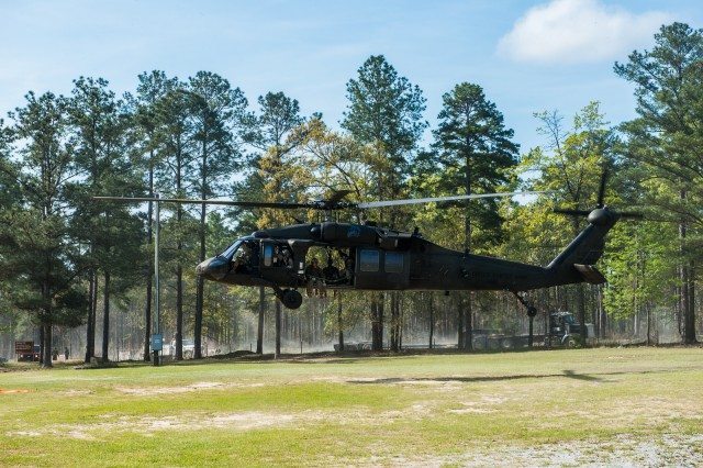 FORT BENNING, Ga. (April 13, 2018) -- A helicopter prepares to take 2018 Best Ranger Competition teams to York Field at Fort Benning's main post. On the first day of the 2018 Best Ranger Competition, 51 teams of two Ranger-qualified U.S. military service members took on several events to test their physical endurance, mental acumen, and technical and tactical skills. The 35th David E. Grange Jr. Best Ranger Competition, an annual competition organized by the Airborne and Ranger Training Battalion, is set to determine the most elite Ranger-qualified two-athlete team of the Armed Services April 13 through 15 at Fort Benning, Georgia. (U.S. Army photo by Patrick Albright, Maneuver Center of Excellence, Fort Benning Public Affairs Office)