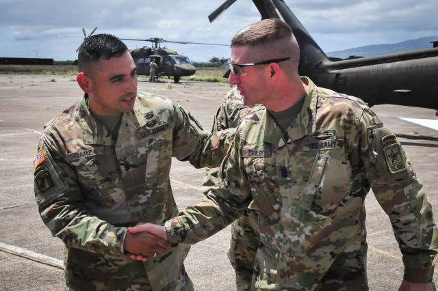 Sergeant Major of the Army Daniel A. Dailey is greeted by Command Sgt. Maj. Jacinto Garza, senior enlisted advisor for the 8th Theater Sustainment Command, during his visit to Hawaii April 12. During his time with the 8th TSC, Dailey met with Soldiers of the 545th Harbormaster Detachment during a field training exercise in which they set up their Harbormaster Command and Control Center (HCCC). With the HCCC, the 545th is able to maintain situational awareness and command and control of any harbor and/or littoral environment. (U.S. Army photo by Sgt. 1st Class Michael Behlin)