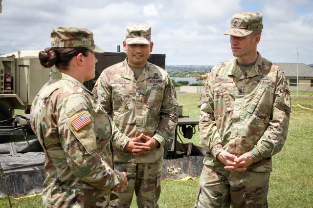 Spc. Brittany Richard, a watercraft operator with the 545th Transportation Company, briefs Sergeant Major of the Army Daniel A. Dailey on the capabilities of the Harbormaster Command and Control Center (HCCC) during his visit to historic Ford Island and the unit's field training exercise April 12. (U.S. Army photo by Sgt. 1st Class Michael Behlin)