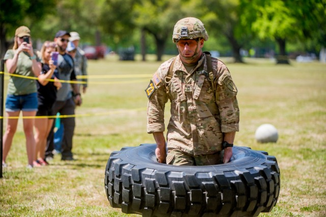 FORT BENNING, Ga. (April 14, 2018) -- Sgt. 1st Class Joshua Rolfes, Airborne and Ranger Training Brigade and Team 23 during the Best Ranger Competition, lifts a tire during the York Field Event of the Best Ranger Competition April 13. After a night of marching April 13, only 24 teams will continue into the second day of the Best Ranger Competition April 14 at Fort Benning, Georgia. The field of competition narrowed as the teams took part in several night events and moved on to the Spartan Race at Dekkar Strip. (U.S. Army photo by Patrick Albright, Manuever Center of Excellence, Fort Benning Public Affairs)