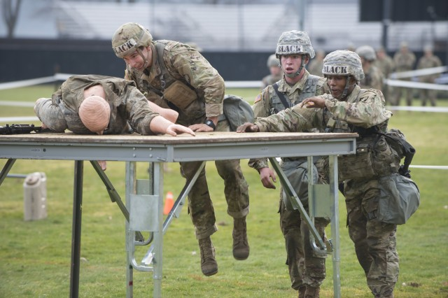 U.S. Military Academy cadets perform a functional fitness task during the Sandhurst Military Skills Competition at West Point, New York, April 13, 2018. The 50th annual competition had 64 squads from the Academy, and other service academies and ROTC detachments from across the country as well as 14 other nations.