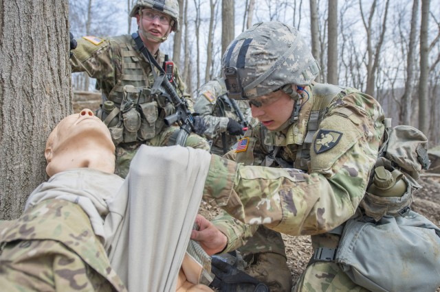 A U.S. Military Academy cadet performs casualty care on a dummy during the Sandhurst Military Skills Competition at West Point, New York, April 13, 2018. The 50th annual competition had 64 squads from the Academy, and other service academies and ROTC detachments from across the country as well as 14 other nations.