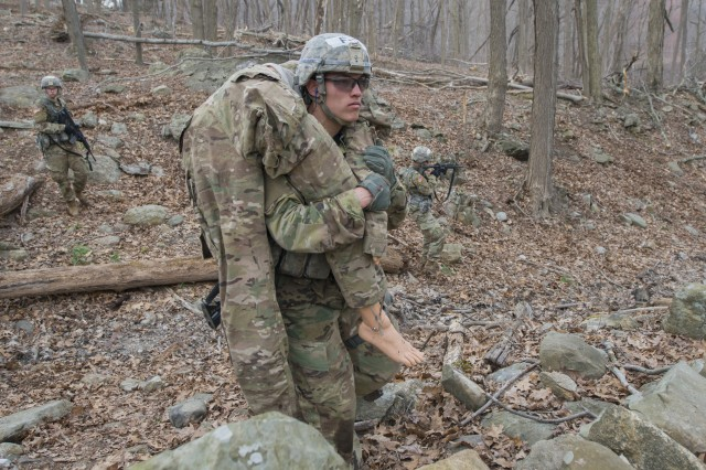 A U.S. Military Academy cadet evacuates a simulated casualty during the Sandhurst Military Skills Competition at West Point, New York, April 13, 2018. The 50th annual competition had 64 squads from the Academy, and other service academies and ROTC detachments from across the country as well as 14 other nations.