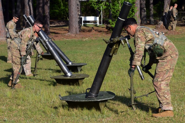 Competitors swing 120mm mortars 360 degrees at the Best Mortar Competition at Fort Benning, Ga., April 14, 2018. Each mortar weighs hundreds of pounds.