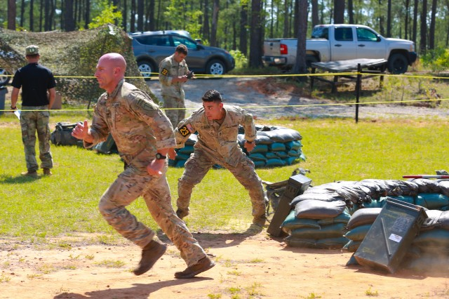 FORT BENNING, Ga. (April 15, 2018) -- Sgt. 1st Class Joshua Rolfes and Sgt. 1st Class Anthony Allen, Team 23 of the Airborne and Ranger Training Brigade, race to put together a mortar system during the day stakes on Todd Field during the second day of the 2018 Best Ranger Competition April 14 at Fort Benning, Georgia. Only 16 teams remain during the third and final day of the 2018 Best Ranger Competition April 15 at Fort Benning, Georgia. The David E. Grange Jr. Best Ranger Competition was organized in 1982 to determine the best Ranger in the Ranger Department, but has since expanded to include all Ranger-qualified Soldiers throughout the entire Army and other willing Ranger-qualified service members from sister services. The competition tests the team members' physical abilities, mental agility, and technical and tactical skills under stressful conditions throughout three days with no scheduled sleep. (U.S. Army photo by Markeith Horace, Maneuver Center of Excellence, Fort Benning Public Affairs)