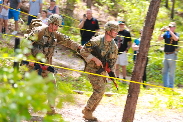 FORT BENNING, Ga. (April 15, 2018) -- First Lt. Gabriel Wentlandt and 1st Lt. Michael Callas, Team 17 of the 101st Airborne Division, run through the medical lane of the day stakes at Todd Field during the second day of the 2018 Best Ranger Competition April 14 at Fort Benning, Georgia. Only 16 teams remain during the third and final day of the 2018 Best Ranger Competition April 15 at Fort Benning, Georgia. The David E. Grange Jr. Best Ranger Competition was organized in 1982 to determine the best Ranger in the Ranger Department, but has since expanded to include all Ranger-qualified Soldiers throughout the entire Army and other willing Ranger-qualified service members from sister services. The competition tests the team members' physical abilities, mental agility, and technical and tactical skills under stressful conditions throughout three days with no scheduled sleep. (U.S. Army photo by Markeith Horace, Maneuver Center of Excellence, Fort Benning Public Affairs)