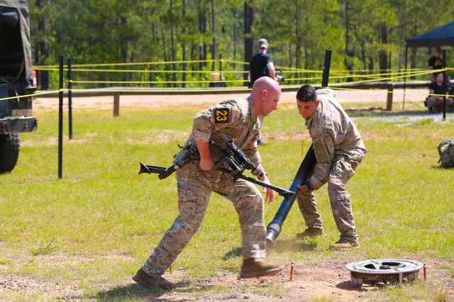 "FORT BENNING, Ga. (April 15, 2018) -- Sgt. 1st Class Joshua Rolfes, left, and Sgt. 1st Class Anthony Allen, right, of Team 23 race to assemble an 81 mm mortar system April 14 on Todd Field at Fort Benning, Georgia. From a field of 51 teams of two Ranger-qualified service members, Team 23 from the Airborne and Ranger Training Brigade won the title of ""Best Ranger"" for the 2018 Best Ranger Competition April 15 at Fort Benning, Georgia. Rolfes and Allen of Team 23 completed three days of events that tested their physical endurance, mental agility, and technical and tactical skills April 13 through 15 as part of the competition, which included no scheduled sleep."