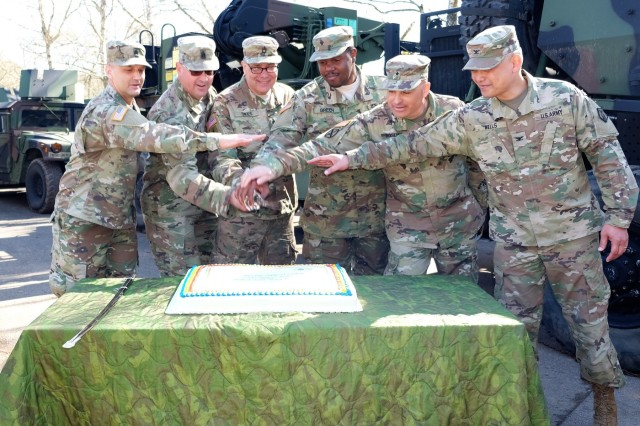 7th Mission Support Command leaders and Soldiers join leaders from the United States Army Reserve to cut a cake in honor of the 110th USAR birthday April 14, 2018 in Baumholder, Germany.