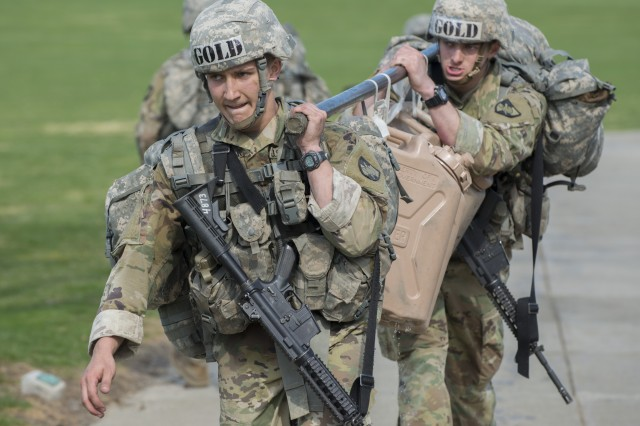 "U.S. Military Academy cadets carry 5-gallon water jugs as part of the ""Burden"" event during the Sandhurst Military Skills Competition at West Point, New York, April 14, 2018. The 50th annual competition had 64 squads from the Academy, and other service academies and ROTC detachments from across the country as well as 14 other nations."