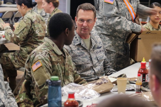 Chief of the National Guard Bureau, Air Force Gen. Joseph L. Lengyel, joins Pvt. Darryl Williams, a supply specialist, and other members of the South Carolina National Guard, for a lunch of Meals, Ready-to-Eat during Guardian Response 18 at Muscatatuck Urban Training Center, in Indiana on April 14, 2018. The exercise is linked to Vibrant Response 18 and is the multi-component U.S. Army North annual disaster response exercise is designed to validate nearly 5,200 military and government civilian personnel in the event of a Chemical, Biological, Radiological and Nuclear (CBRN) disaster.