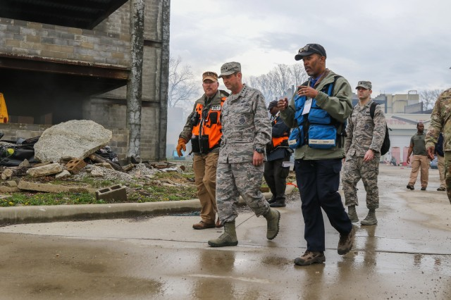 Chief of the National Guard Bureau, Air Force Gen. Joseph L. Lengyel, along with distinguished visitors, including commanding officers from across the nation, observe Soldiers conducting exercise operations, including urban search and rescue efforts, during Guardian Response 18 at Muscatatuck Urban Training Center, in Indiana on April 14, 2018. The exercise is linked to Vibrant Response 18 and is the multi-component U.S. Army North annual disaster response exercise is designed to validate nearly 5,200 military and government civilian personnel in the event of a Chemical, Biological, Radiological and Nuclear (CBRN) disaster.