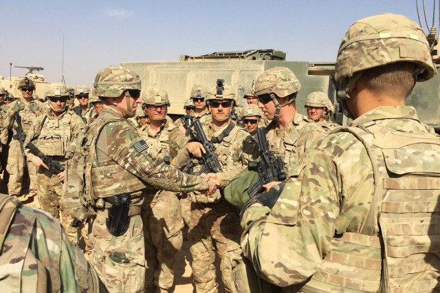 "Gen. Robert B. ""Abe"" Abrams, commanding general of the Forces Command, speaks with Soldiers from the 4th Battalion, 27th Field Artillery Regiment, 1st Armored Division, at Tactical Assembly Area Fuhaymi, Iraq, while conducting battlefield circulation in the U.S. Central Command area of responsibility in November 2017."