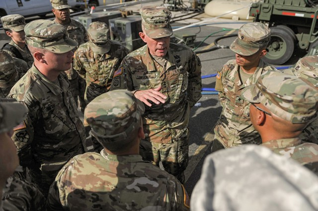 Lt. Gen. Charles D. Luckey, chief of the Army Reserve, met 597th Quartermaster Company Soldiers in San Juan, Puerto Rico, on Oct. 21, 2017. The Soldiers were there to provide laundry and shower services to refugees affected by Hurricanes Irma and Maria.
