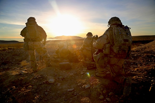 Soldiers assigned to the 1st Battalion, 38th Infantry Regiment, 1st Stryker Brigade Combat Team, scan the area for enemy threats during a National Training Center rotation at Fort Irwin, Calif., on Jan. 15, 2018. Decisive action training exercises at the center help units to remain versatile, responsive, and available for contingencies.