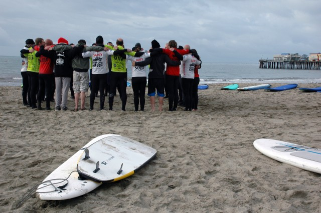 CAPITOLA, California -- Disabled veterans and Operation Surf instructors gather for last-minute inspiration before taking their surfboards into the ocean here March 24.