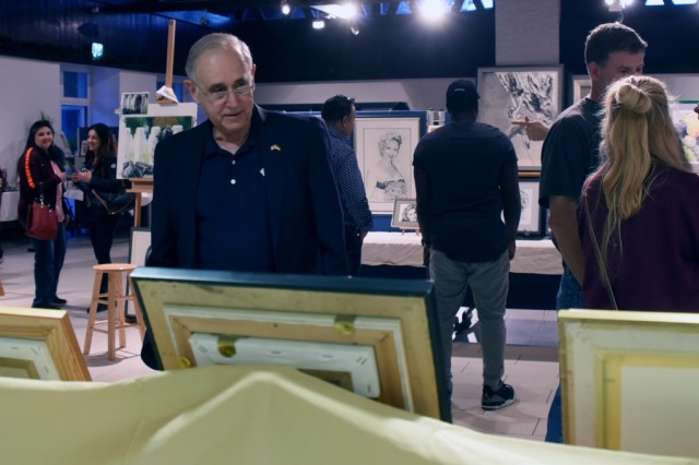 GARMISCH-PARTENKIRCHEN, Germany (April 16, 2018) - Retired U.S. Army Lt. Gen. Keith Dayton, director of the George C. Marshall European Center for Security Studies, looks at artwork from Connie Trautmann, Marshall Center's protocol specialist, at the 4th Annual Garmisch Community Art Show held April 14 at the Pete Burke Community Center on Artillery Kaserne. (Marshall Center photo by Christine June)