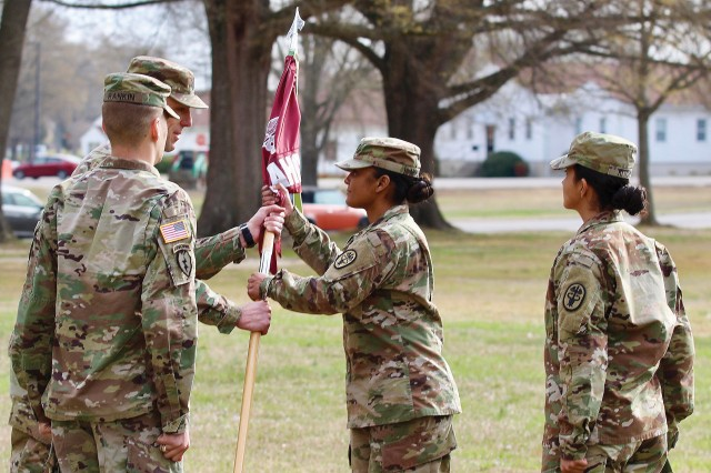 180412-A-PE074-0013 Lt. Col. Paul J. Kassebaum, Kenner Army Health Clinic commander hands the KAHC guidon to Capt. Kathy M. Morales, incoming Medical Company Operation's change of command ceremony April 12 at KAHC front lawn. Morales assumed command from outgoing OIC, Capt. Blayne A. Rankin. (Photo by Lesley Atkinson, KAHC Public Affairs)