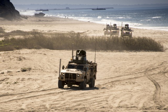 Marines with Weapons Company, 1st Battalion, 7th Marine Regiment, Twentynine Palms, Calif., perform Amphibious Landing missions at Camp Pendleton, Calif., during Joint Light Tactical Vehicle operational testing.