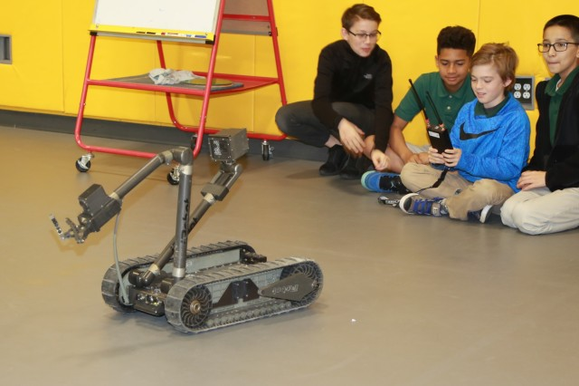 FORT BENNING, Ga. (April 17, 2018) -- Students of Faith Middle School control an Army robotics platform April 9 at Fort Benning, Georgia. Fort Benning schools dedicated a week to the Science, Technology, Engineering and Mathematics programs April 9 through 13 to equip students with the skills, abilities and knowledge that will prepare them for college and 21st century careers. (U.S. Army photo by Markeith Horace, Maneuver Center of Excellence, Fort Benning Public Affairs)