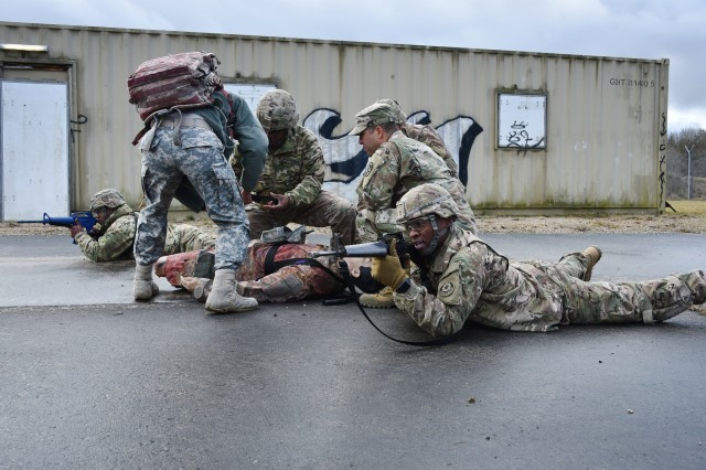 Chap. (Capt.) Joseph Effiong, an 18th Military Police Brigade chaplain, provides religious care while religious affairs specialists and medics assess an exercise casualty and provide security during the Combat Medical Ministry and Emergency Medical Ministry Courses March 12-21. The CMM and EMM courses help prepare chaplain teams to deal with the impact of combat on Soldiers.