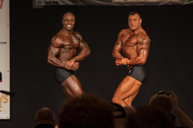 174th Infantry Brigade Soldiers Staff Sgt. Jamie Kedrowicz (right) and Capt. Kevon Reid (left) square off at the 2018 Steve Stone Metropolitan Bodybuilding Championships in Teaneck, New Jersey Mar. 31. Staff Sgt. Kedrowicz and Capt. Reid finished first and second in the Men's Classic Physique division. (Courtesy Photo)