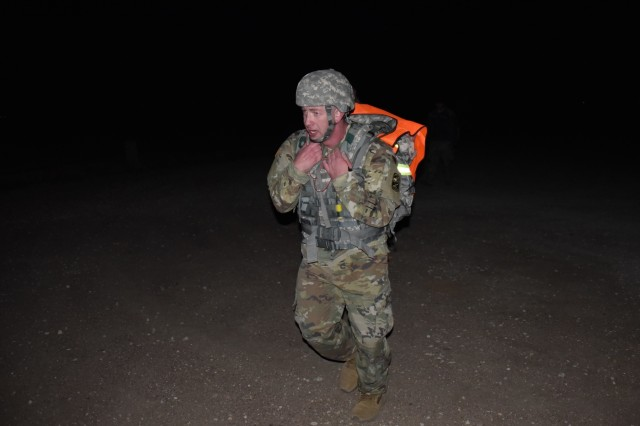 Sgt. Eric Roberts, 100th Missile Defense Brigade, approaches the half-way point during a 12-mile ruck march at Fort Carson as part of the U.S. Army Space and Missile Defense Command/Army Forces Strategic Command's Western Region Best Warrior Competition.  Roberts was named the noncommissioned officer Best Warrior.