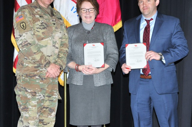 TACOM Chief of Staff Col. Jeffrey Witt presented two-star notes to Gail Lippert and Jim Twardesky on behalf of TACOM Commanding General Maj. Gen. Clark LeMasters.