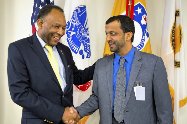 (From left) Security Assistance Command Executive Director Robert Moore meets with Brig. Gen. Rashed AlMehrzi, staff engineer and director of logistics for the UAE Air Force and Air Defense, at USASAC headquarters. AlMehrzi  recognized security assistance enterprise employees for their quick turnaround assistance during a gathering in Huntsville.