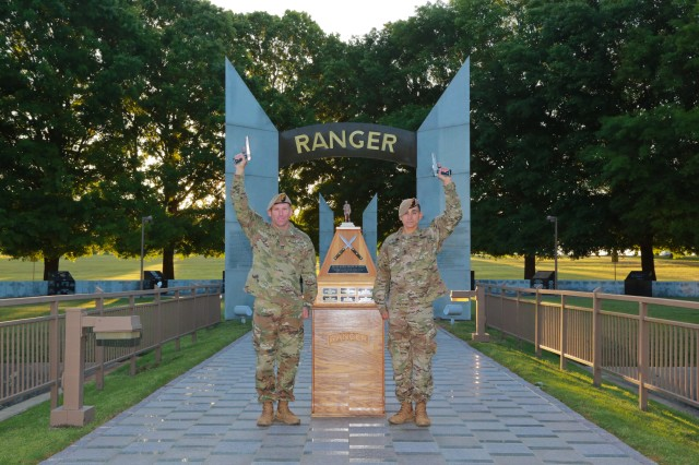 FORT BENNING, Ga. (April 17, 2018) -- From left, Sgts. 1st Class Joshua Rolfes and Anthony Allen of the Airborne and Ranger Training Brigade pose at the Ranger Monument April 16 at Fort Benning, Georgia. Rolfes and Allen were Team 23 during the 2018 Best Ranger Competition at Fort Benning, Georgia, and won the competition. (U.S. Army photo by Markeith Horace, Maneuver Center of Excellence, Fort Benning Public Affairs)