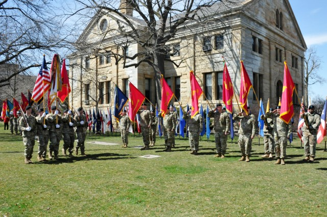 The Army Sustainment Command Color Guard retires the colors in front of the flags of the 16 sub-ordinate installations Joint Munitions Command manages during the Relinquishment of Command Ceremony held on the Rock Island Arsenal, April 17.