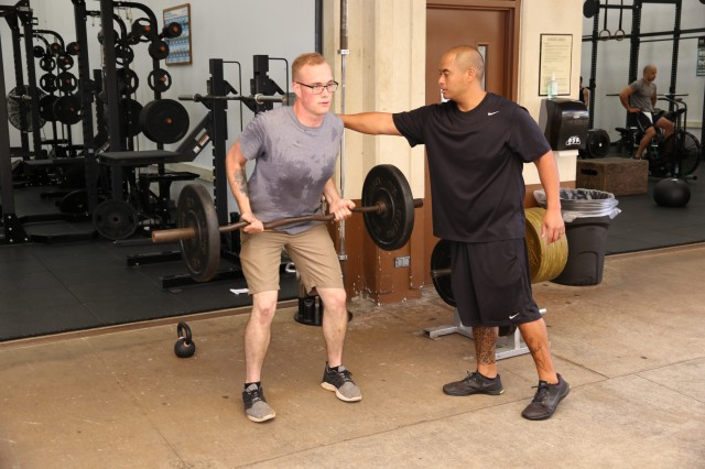 A reconditioning Soldier receives hands-on instruction from Neil Santiago, human performance program specialist, USAHC-SB. A core component of Soldier rehabilitation is closely monitored physical training and steady progression in addition to unit level training.