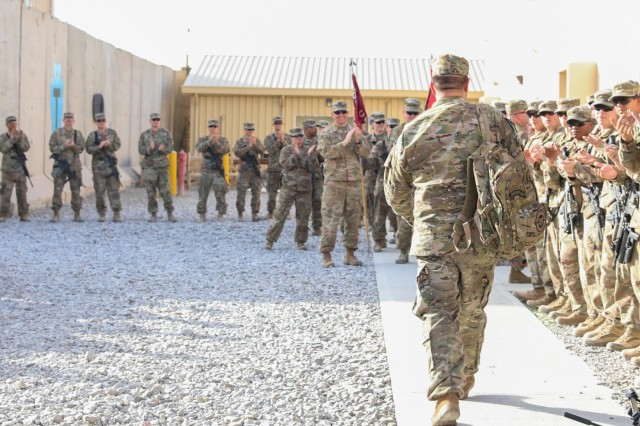 Soldiers of Train, Advise and Assist Command-South, composed of Soldiers from the 40th Infantry Division, California National Guard and 2nd Infantry Brigade Combat Team, 4th Infantry Division, welcome retired Master Sgt. Leroy Petry, medal of honor recipient, April 5, 2018, during Operation Proper Exit on Kandahar Airfield, Afghanistan.