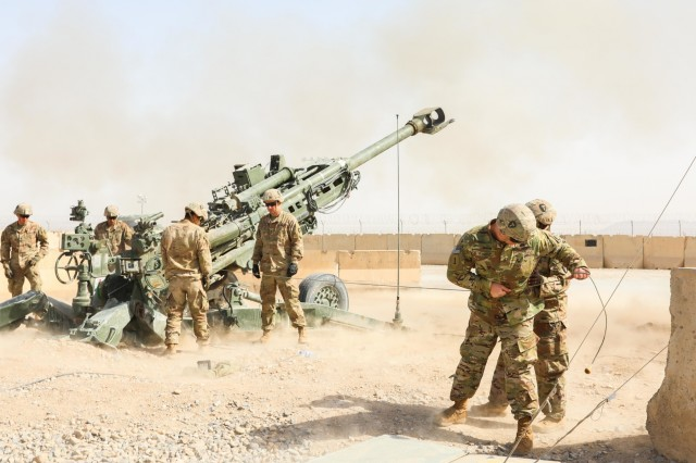 Retired Sgt. Franz Walkup, a native of Tennessee, fires a M77 Howitzer, April 5, 2018, during Operation Proper Exit on Kandahar Airfield, Afghanistan.