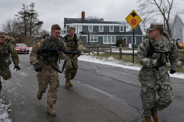 Competitors in the NH Army National Guard's Best Warrior Competition sprint during the final leg of a 12 mile ruck march in New Castle, NH on April 15. The ruck march was one of many events competitors were evaluated on to determine title of the NH National Guard's Soldier and NCO of the year.