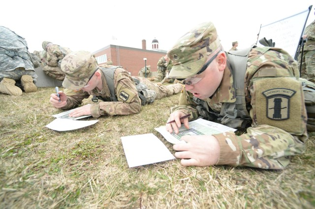 From left, Cpl. Sawyer Lyman and Sgt. Austin Lyman of 3rd Battalion, 197th Field Artillery Regiment, NH Army National Guard, plot points during the 2018 Best Warrior Competition at the Regional Training Institute in Center Strafford on April 13. The brothers were among more than 20 soldiers and airmen from the NH National Guard and Canadian army who competed in the annual, three-day event.