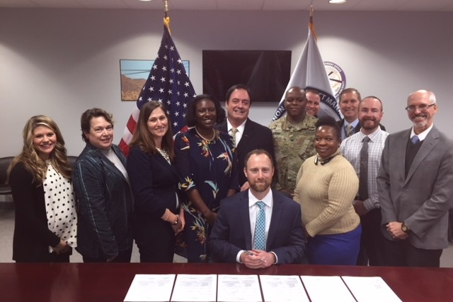 Sitting: Contracting Officer -- Mr. Barry Byrd.  Standing Left to Right:  Kalie Meadows, Julia Kidd, Amy Clark, LaTasha Porter - Contract Specialist, Patrick O'Farrell, COL Calvin Lane, Joshua Smothers, Sofia Colquiett, Eric Post, Brandon Williams, Jay Carlson.  Not pictured: M.D. Batts, Contract Specialist.