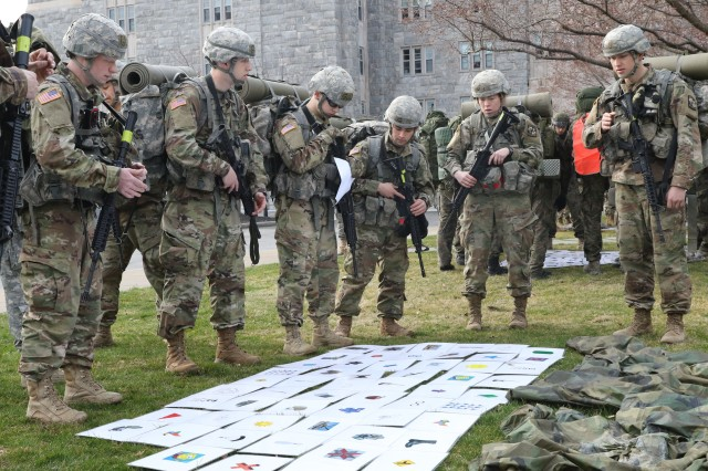 Georgetown University Cadets work together to memorize a puzzle before the start of the Sandhurst Military Skills competition at West Point April 13.