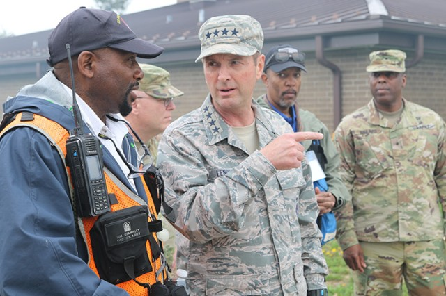 Tim Stampley, a Department of the Army civilian observer controller trainer, and his crew, speaks to Gen. Joseph L. Lengyel, Chief of the National Guard Bureau, and gives him a tour of the training during Guardian Response 18 at Muscatatuck Urban Training Center, Ind., April 14, 2018.