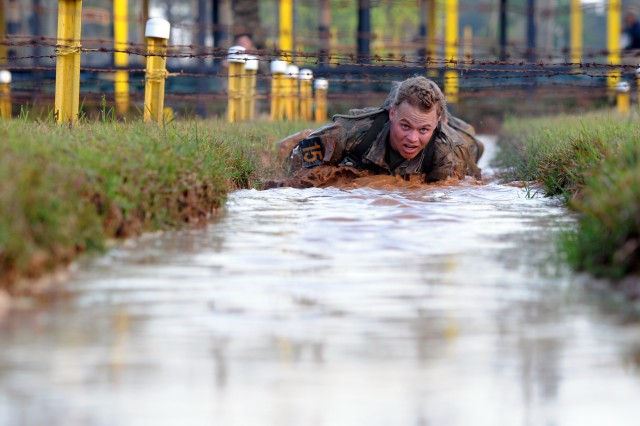 1st Lt. Tye Smarjesse, a Bravo Company, 2nd Battalion, 505th Parachute Infantry Regiment, 3rd Brigade Combat Team paratrooper, crawls under barbed wire during the Malvesti event of the 2018 Best Ranger Competition at Fort Benning, Georgia on Apr. 13. The Malvesti consisted of six obstacles.