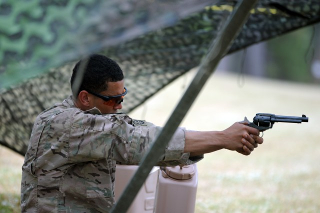 Staff Sgt. Carlos Mercado, a Delta Company, 1st Battalion, 505th Parachute Infantry Regiment, 3rd Brigade Combat Team paratrooper, practices his firing position inside the holding area of the mystery event of the Day Stakes portion of the 2018 Best Ranger Competition at Fort Benning, Georgia on Apr. 14. The Colt revolver was one of several firearms the teams were required to shoot during the mystery event.