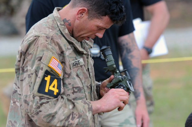 Staff Sgt. Christopher Hart, a Charlie Company, 1st Battalion, 508th Parachute Infantry Regiment, 3rd Brigade Combat Team paratrooper, adjusts the sighting device of the 81mm mortar during the 81mm mortar lane of the Day Stakes portion of the 2018 Best Ranger Competition at Fort Benning, Georgia on Apr. 14. Teams had eight minutes and one attempt to successfully mount an 81mm mortar and place out aiming posts.