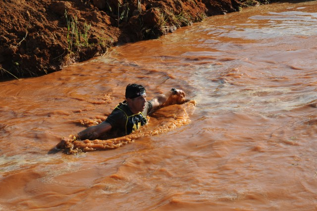 Staff Sgt. Christopher Hart, a Charlie Company, 1st Battalion, 508th Parachute Infantry Regiment, 3rd Brigade Combat Team paratrooper, moves through muddy water during the Spartan Race portion of the 2018 Best Ranger Competition at Fort Benning, Georgia on Apr. 14. This is the first time that Hart has competed in the Best Ranger Competition.