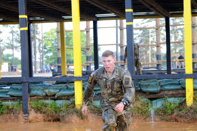 1st Lt. Colton Motz, Delta Company, a 1st Battalion, 508th Parachute Infantry Regiment, 3rd Brigade Combat Team paratrooper, enters a water pit during the Malvesti event of the 2018 Best Ranger Competition at Fort Benning, Georgia on Apr. 13. The Malvesti was an obstacle course that consisted of six obstacles.
