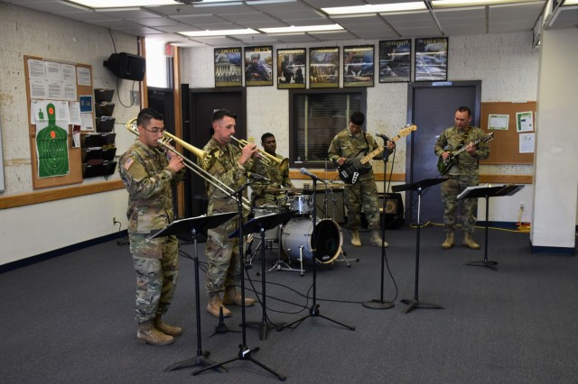 The Military Intelligence Corps Band performs for attendees on the Phoenix Recruiting Battalion's Educators Tour of Fort Huachuca, April 11. This was the final performance for the band, who is being disbanded. (U.S. Army Photo by Alun Thomas, USAREC Public Affairs)