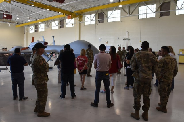 Attendees from the Phoenix Recruiting Battalion's Educators Tour receive a brief on unmanned aerial systems, from a noncommissioned officer at the UAS school, Libby Army Airfield, April 11, Fort Huachuca, Ariz. The purpose of the two-day tour was to provide a comprehensive orientation and overview of Fort Huachuca for the 15 attendees, who included teachers, superintendents and school counselors from the battalion area of influence. (U.S. Army Photo by Alun Thomas, USAREC Public Affairs)