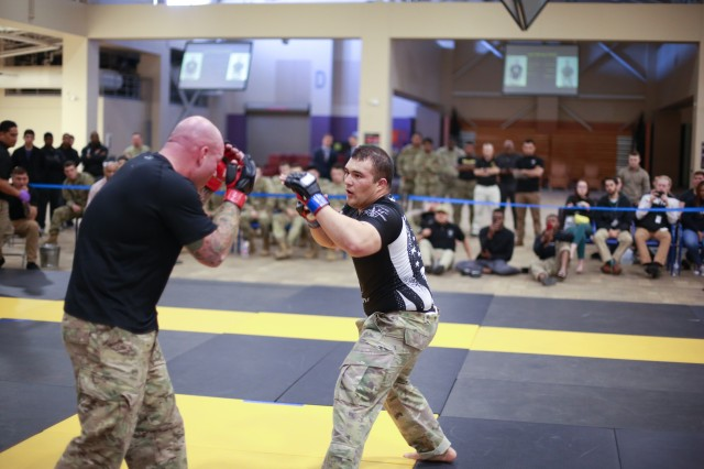 FORT BENNING, Ga. (April 18, 2018) -- Two Soldiers square off during the final day of the Lacerda Cup combatives tournament April 17 at Fort Benning, Georgia. The 2018 Lacerda Cup, an annual all-Army combatives tournament, concluded when the 3rd Cavalry Regiment from Fort Hood, Texas, won the team championship event. (U.S. Army photo by Markeith Horace, Maneuver Center of Excellence, Fort Benning Public Affairs)