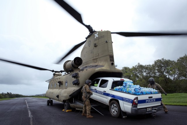 Soldiers from the 25th Combat Aviation Brigade, 25th Infantry Division, load a law enforcement vehicle laden with water onto a CH-47 Chinook April 17 to assist in disaster relief operations in northern Kauai after severe rains, flooding and mudslides stranded hundreds of residents and tourists. 25th Infantry Division Soldiers transported emergency vehicles, food, water, bedding, hygiene products and other supplies to affected areas, and transported people stranded to Camp Naue near Princeville, Kauai. 25th Inf. Div. aviation assets were tasked to support relief efforts after the state requested assistance through U.S. Pacific Command. (U.S. Army photo by Staff Sgt. Keith Anderson, 25th Infantry Division Public Affairs)